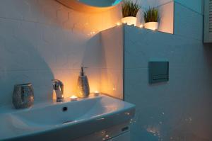 Łazienka w obiekcie Apartament UZIEMIENIE