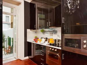 A kitchen or kitchenette at Lisbon Colours Bairro Alto Apartments