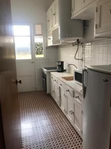 A kitchen or kitchenette at Lagos Center Studios