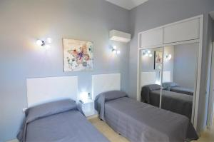 A bed or beds in a room at Tenerife Holiday Villa Mariposa with Pool