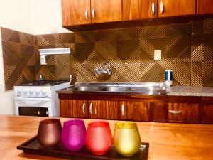 A kitchen or kitchenette at Del Rio Apart Hotel