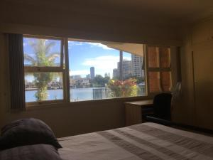 A bed or beds in a room at Riverfront Oasis
