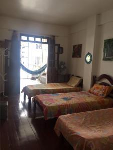 A bed or beds in a room at BARRA - 3 Quartos / 3 Banheiros - Amplo, Aconchegante e Artesanal