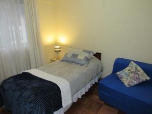 Cama ou camas em um quarto em Curicó Portugal Apartment