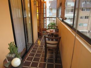 Uma varanda ou terraço em Curicó Portugal Apartment