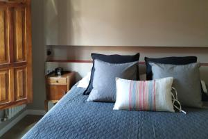 A bed or beds in a room at Galicia Home