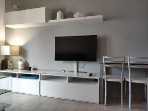 A television and/or entertainment center at Canyamel Beach