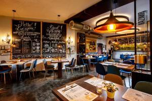 Restoranas ar kita vieta pavalgyti apgyvendinimo įstaigoje Spatz Aparthotel