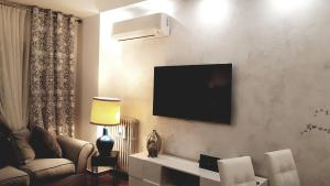 A television and/or entertainment center at IMMENSO AMORE