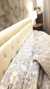 A bed or beds in a room at IMMENSO AMORE