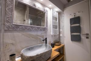 A bathroom at Rastoni Athens Suites near Acropolis at Tsatsou street