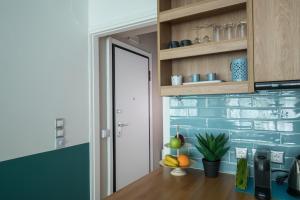 A kitchen or kitchenette at Rastoni Athens Suites near Acropolis at Tsatsou street