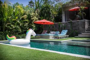 The swimming pool at or near Silversand Villa
