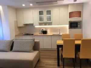 A kitchen or kitchenette at ★ Exclusive Central Apartment ★ FREE Garage ★