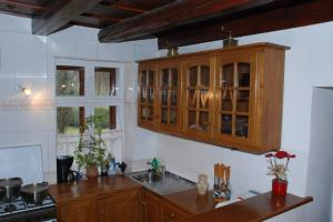 A kitchen or kitchenette at Sörényes Udvarház