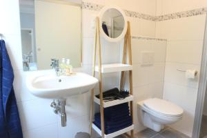 Ein Badezimmer in der Unterkunft Apartments Obdach