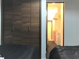 Ein Bett oder Betten in einem Zimmer der Unterkunft Deluxe Cozy Apartment