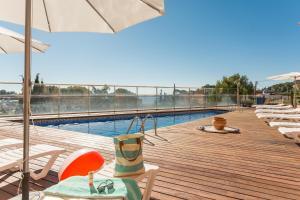 Het zwembad bij of vlak bij Pierre & Vacances Villa Romana
