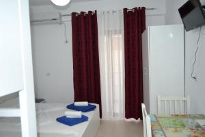 A bed or beds in a room at Vila Renato