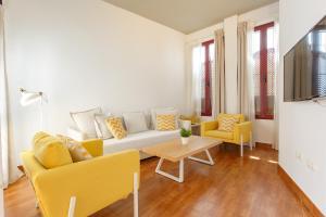 Zona de estar de Apartamentos Sherry Center