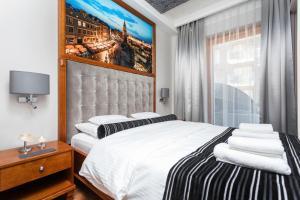 Lova arba lovos apgyvendinimo įstaigoje Diamonds Luxury Old Town Residence