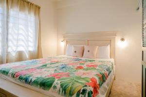 A bed or beds in a room at Babylon Beach Resort