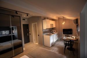 Кухня или мини-кухня в Cityloft 36