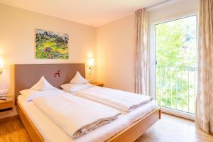 Łóżko lub łóżka w pokoju w obiekcie Allegra Wohlfühl Appartements