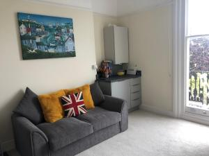 A seating area at Wight On The Beach, Slps4, Stylish Apartment, Balcony with Sea Views