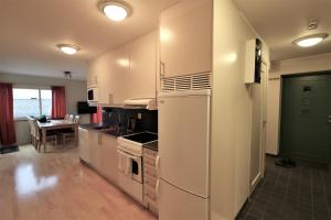 Ett kök eller pentry på RIBO Apartment Riksgränsen