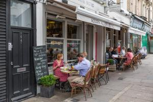 A restaurant or other place to eat at Portobello Road VIII by onefinestay
