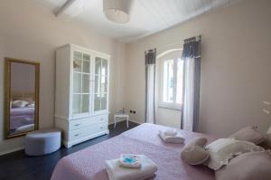 Giường trong phòng chung tại Casa Del Cavaliere
