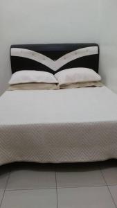 Katil atau katil-katil dalam bilik di Qaseh Homestay