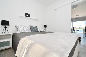 A bed or beds in a room at Apartments Piazza