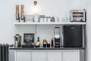 מטבח או מטבחון ב-Home Suite Home Gran Via