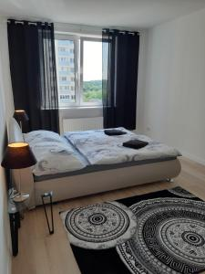 A bed or beds in a room at Danchenko`s apartment