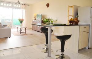 A kitchen or kitchenette at Iaora Nani Residences