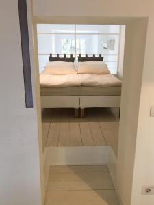 A bed or beds in a room at White Fashion Loft - Milan MM3