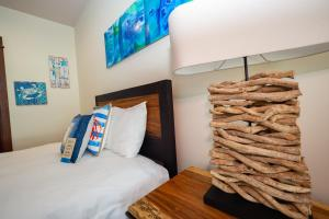 A bed or beds in a room at CRP Crocs Resort
