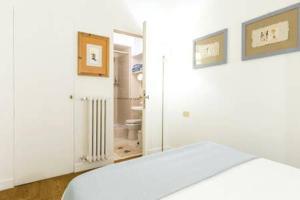 A bed or beds in a room at Casa Tommaso al Vaticano