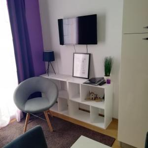 A television and/or entertainment centre at Tomena apartments