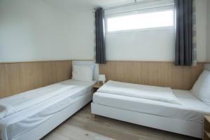 Posteľ alebo postele v izbe v ubytovaní Barack Thermal Resort Apartments