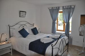 A bed or beds in a room at Clos de La Richaudière