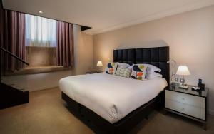 Cama o camas de una habitación en Cheval Phoenix House at Sloane Square