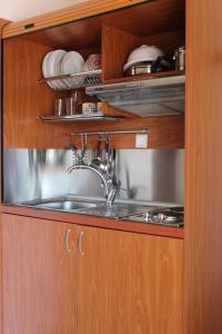 Virtuvė arba virtuvėlė apgyvendinimo įstaigoje La Luna Studios
