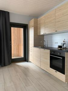 A kitchen or kitchenette at Heima Holiday Homes