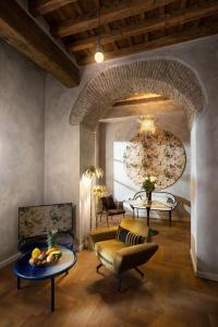 A seating area at Palm Suites - Small Luxury Hotels of the World