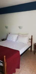 A bed or beds in a room at Rigas Apartments