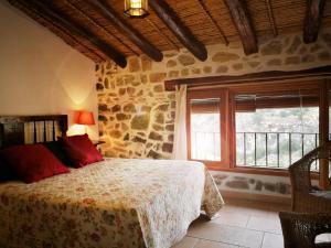 Cama o camas de una habitación en Buhardilla Rústica en la Vall de Gallinera