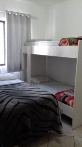 A bunk bed or bunk beds in a room at Apartamento Dante Tomio